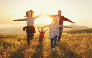 Homepage - Family Running Through Grass